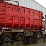 Red Skip Container on Truck